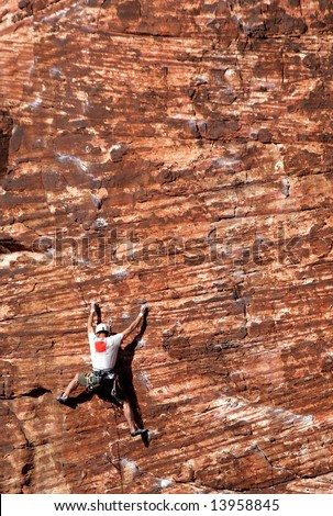 Rock climbing in Red Rock Canyon, Nevada. - stock photo