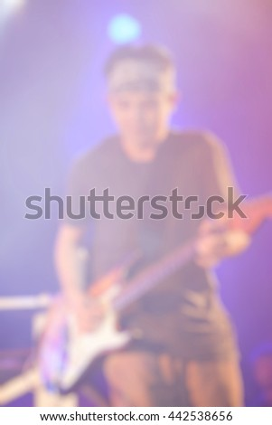 Rock concert stage. Guitarist playing on electric guitar. used for background or material design. space for text - stock photo
