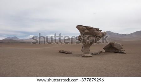 Rock formation (Arbol de Piedra) in Salar de Uyuni, Bolivia. - stock photo