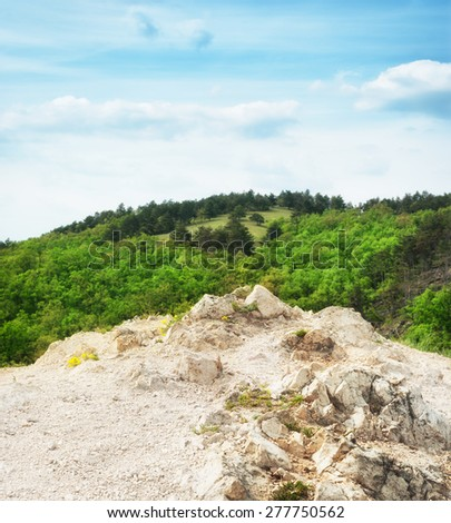 Rock formation on top of the hill. - stock photo
