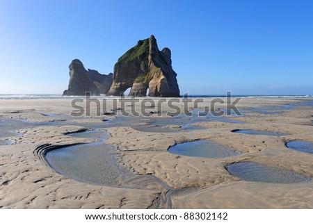 Rock Formation on Wharariki Beach, Golden Bay, New Zealand - stock photo