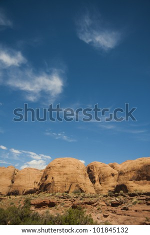 Rock formation under clear blue sky, near Moab Utah - stock photo