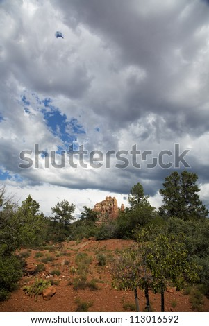 Rock Formation with Storm Clouds Above - stock photo
