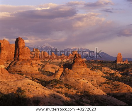 Rock formations and hoodoos in Arches national Park overlooking the LaSal Mountains, Moab Utah - stock photo