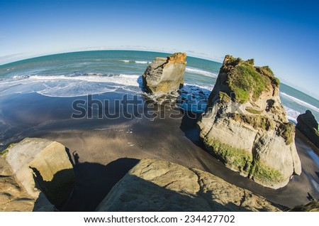 rock formations at the shore - stock photo