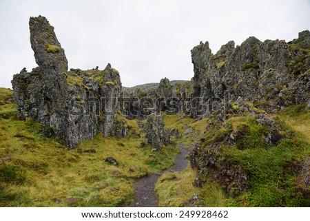 Rock formations in black sand beach of Djupalonssandur, Snaefellsnes peninsula, Iceland - stock photo