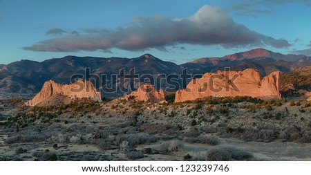 Rock formations in front of Pikes Peak at dawn at the Garden of the Gods in Colorado Springs, Colorado - stock photo