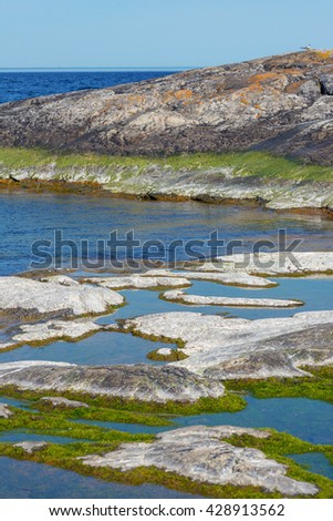 Rock formations in with segments in white at the Baltic shore, Grisslehamn - stock photo