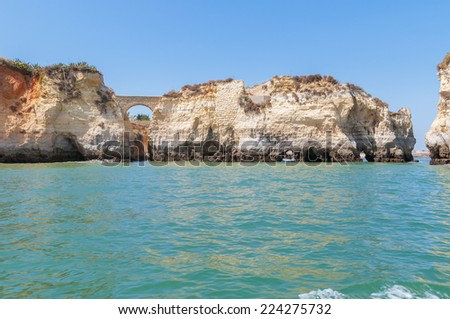 Rock formations near Lagos in Portugal seen from the water - stock photo
