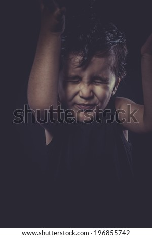 Rock, Funny kid with funny faces dressed as a heavy - stock photo