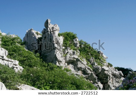 rock, grass and sky at summer - stock photo