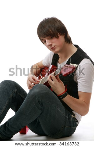 Rock guitarist isolated on white background - stock photo
