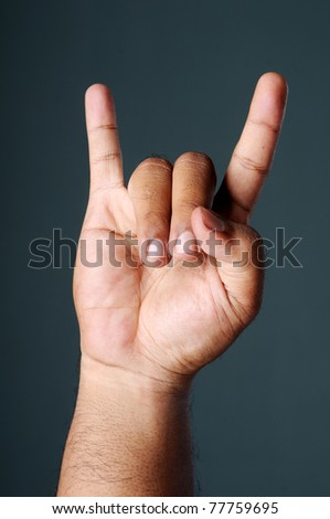 Rock Hands isolated dark grey background - stock photo