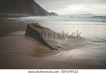 Rock in the sand in the beautiful beach called Campelo - stock photo