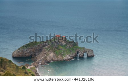 Rock in the sea, the view from the top of the waves and cliffs, turquoise waters - stock photo