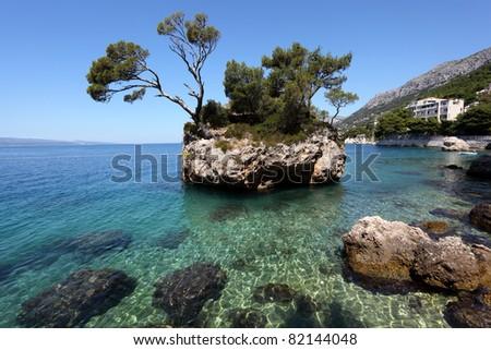 Rock island in Brela, Adriatic coast of Croatia - stock photo
