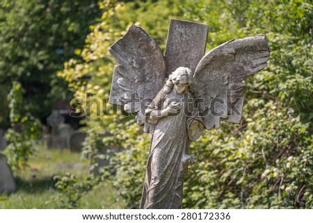 Rock Maria Statue in the graveyard - stock photo