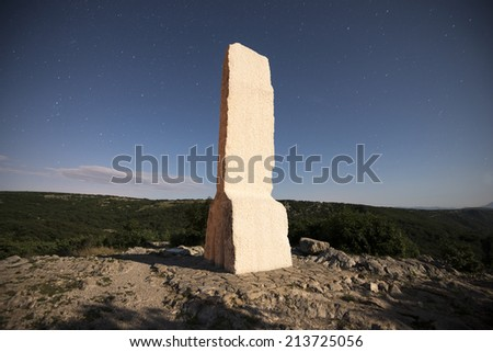 rock monolith at night - long exposure - stock photo