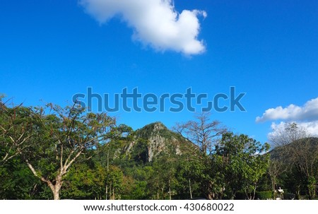 Rock mountain and blue sky and cloud with looked the moon in the daytime - stock photo