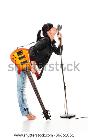 Rock-n-roll girl holding a guitar kissing retro microphone isolated on white - stock photo