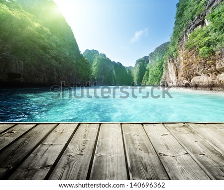rock of Phi Phi island in Thailand and wooden platform - stock photo