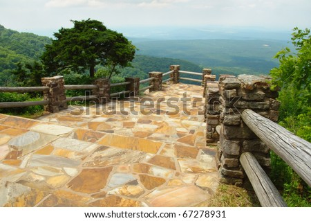 rock overlook of forest hills from Mount Magazine - stock photo