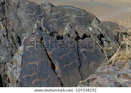 Rock paintings of ancient nomads of Central Asia