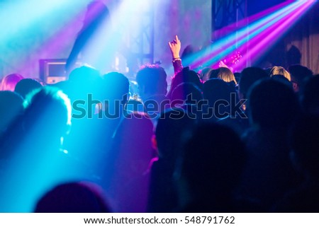 Rock performance, enthusiastic audience