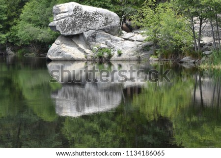 stock-photo-rock-reflection-in-a-lake-gi