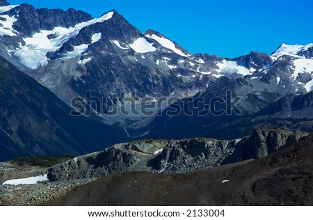 Rock, river, valley, and snow peaks of Blackcomb Mountains. More with keyword group14l