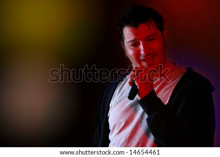 Rock singer on a scene flirting with the audience - stock photo