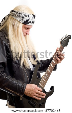 Rock star guitarist on a white background - stock photo