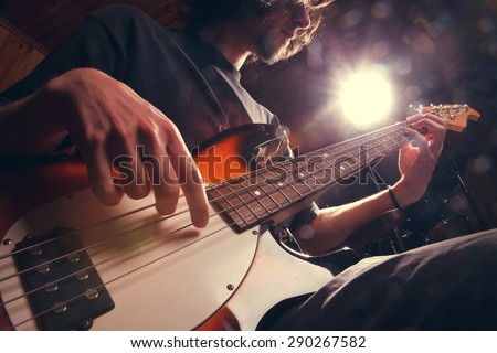 Rock star with a guitar - stock photo