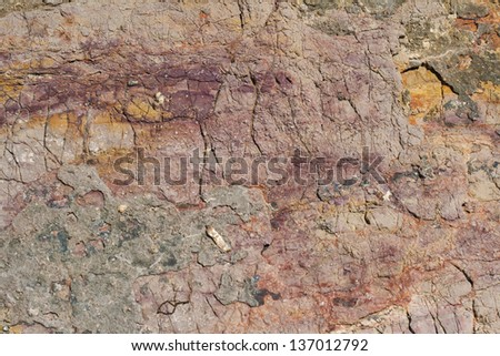 Rock texture with magenta and orange colors - stock photo