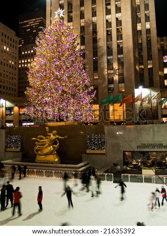 Rockefeller Center, New York, Dec 5th 2008: Ice skaters and tourists are all around the famous Rockefeller Center Christmas tree during the holidays. - stock photo