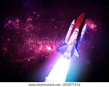 Rocket Against Starry Background - Elements of this Image Furnished By NASA - stock photo