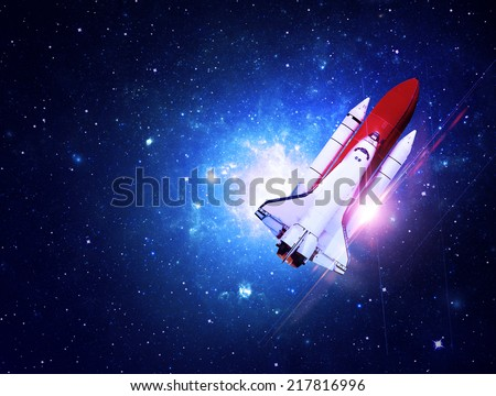 Rocket Flying Through Blue Starfield - Elements of this Image Furnished By NASA - stock photo