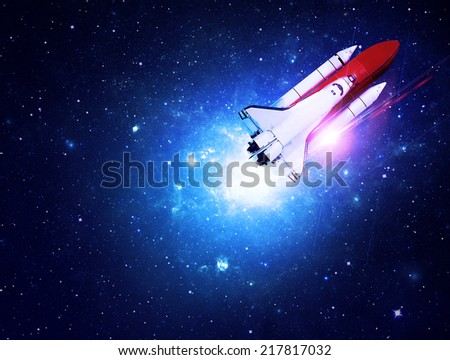Rocket Flying through Starfield - Elements of this Image Furnished By NASA - stock photo