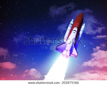 Rocket in Sky - Elements of this Image Furnished By NASA - stock photo