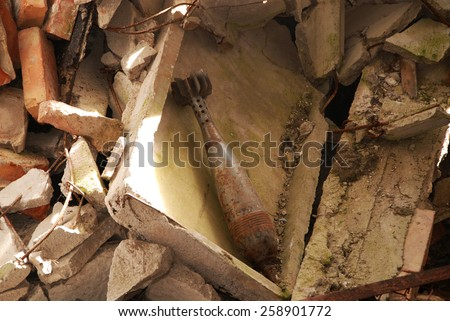 Rocket in the ruins of the house - stock photo