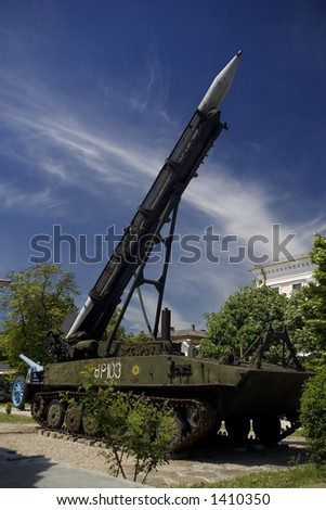 rocket launcher mounted on an armored vehicle - stock photo