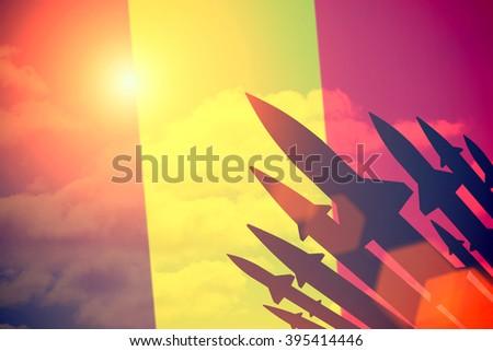 Rockets silhouettes background Belgium flag. Toned - stock photo