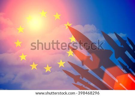 Rockets silhouettes background European Union flag. Toned - stock photo