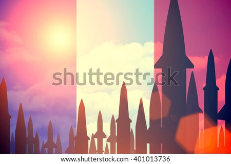 Rockets silhouettes background France  flag. Toned - stock photo