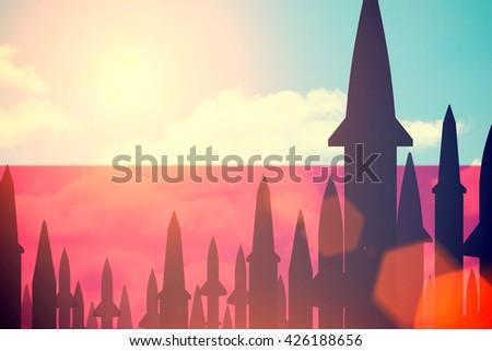 Rockets silhouettes background  Poland flag. Toned - stock photo