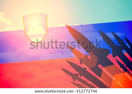 Rockets silhouettes background Slovenia flag. Toned - stock photo