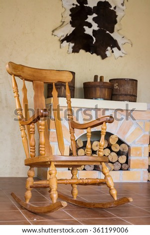 Rocking chair and chimney - stock photo