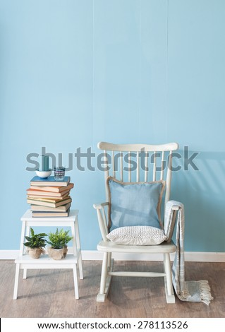 rocking chair with book - stock photo