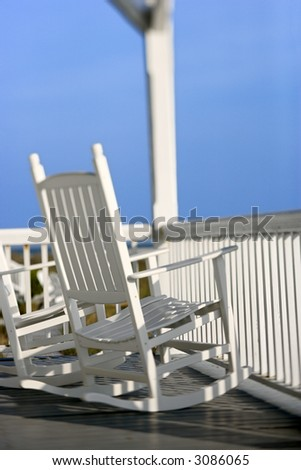 Rocking chairs on porch on Bald Head Island, North Carolina. - stock photo