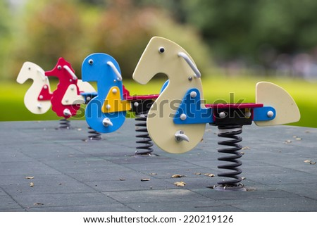 rocking horse in the park - stock photo